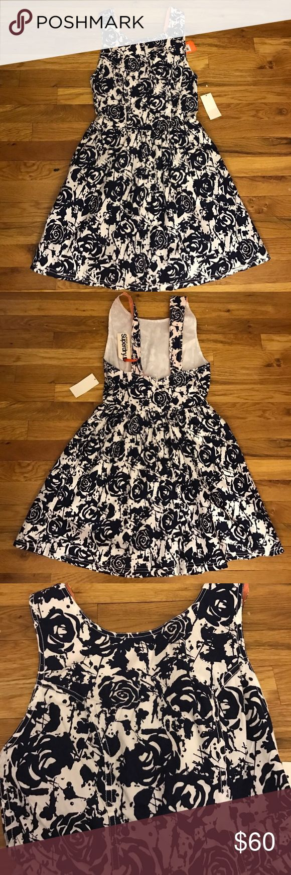 Super dry nwt navy floral dress Size xs! NWT! Pet free and smoke free home. Zips up back Superdry Dresses