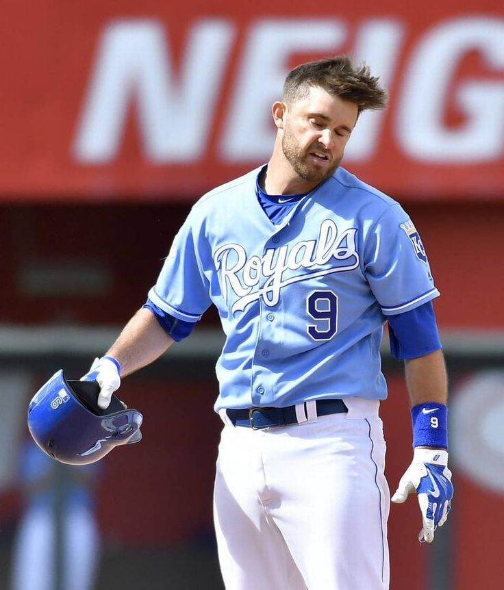 Kansas City Royals' Drew Butera does a hair flip at second after his RBI double scored Eric Hosmer in the ninth inning during Saturday's baseball game against the Chicago White Sox on May 28, 2016 at Kauffman Stadium in Kansas City, Mo.
