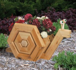 rattle snake planter made from landscape timbers planter project plans landscape timber snail planter garden projectsoutdoor projectswood