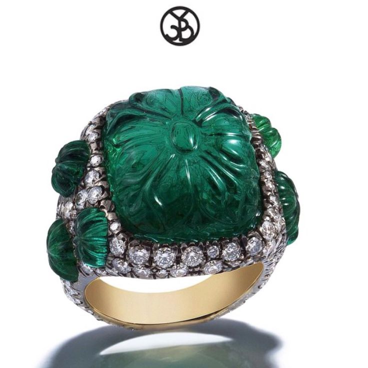 """""""Precision craftsmanship... A rare 20 carat mogul hand carved emerald, surrounded by diamonds and emeralds set in black gold.…"""""""