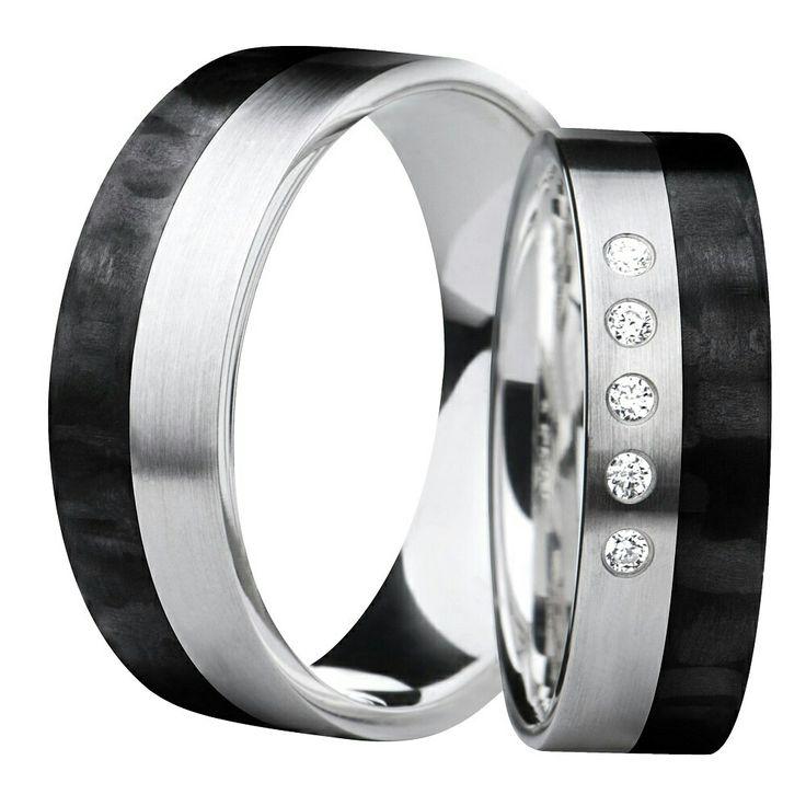 Valkokulta/hiilikuitusormus timanteilla. White gold/carbon ring with diamonds.