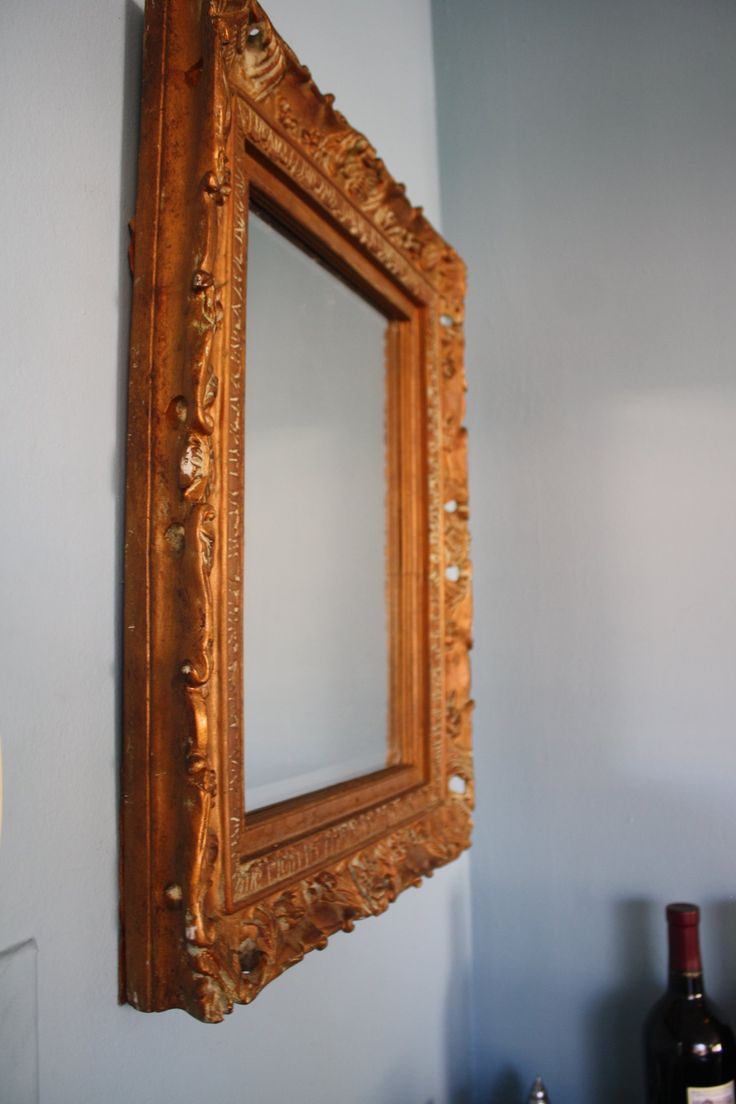 "This ornate and intricately detailed gold framed mirror is very heavy and made with quality. Its beveled edges (the perimeter of the mirror that slant inwards) are signs of craftsmanship, while the beautiful gold color will make a statement in any space. Frame: 17.5""x21"" Mirror: 11""x1"