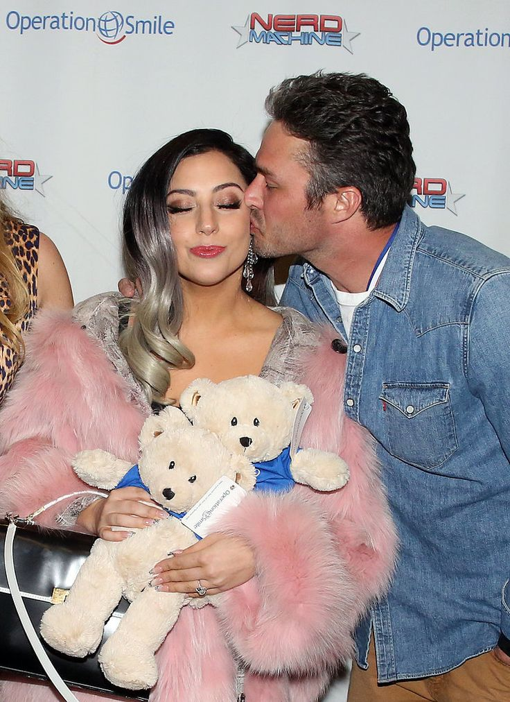 Lady Gaga and Taylor Kinney Are All About the PDA: Lady Gaga and her handsome fiancé, Taylor Kinney, aren't afraid of a little red carpet PDA.
