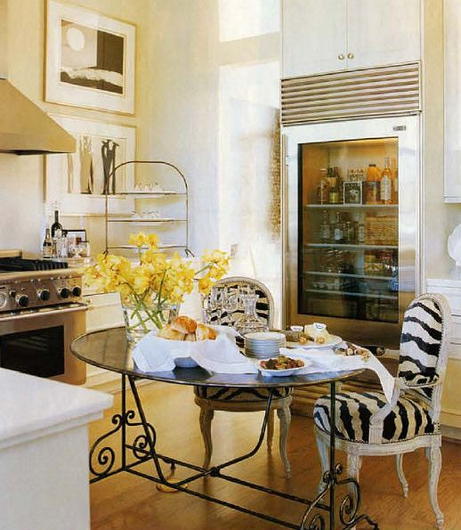 kitchen - photo prints on the wall, the see thru fridge, and the zebra chairs