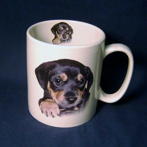 Large Capacity 14 ounce Ceramic MugMug is Jumbo 4 1/4 Tall and 3 1/2 wide plus handle.Features Adorable Images of a   Rottweiler  Puppy both inside and out.Paragraph on the back tells the characteristics of a  Rottweiler