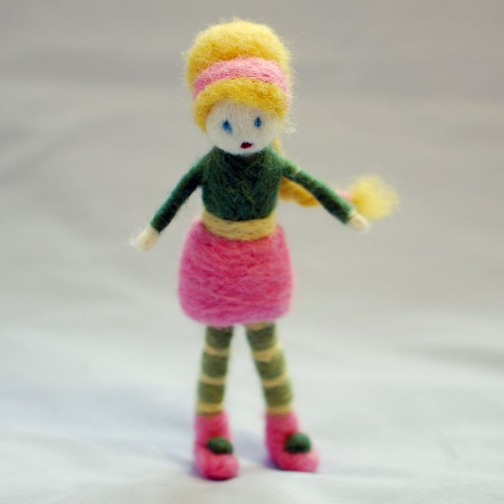 Small needle felted girl. This doll is about 5″ high.