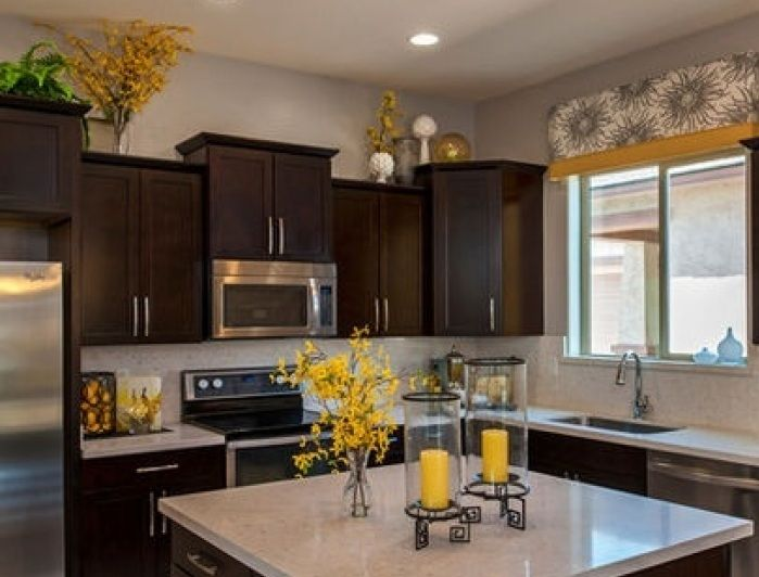 Plants For Kitchen To Decorate It: Greenery Above Kitchen Cabinets Ideas With Artificial Flowers And Leaf