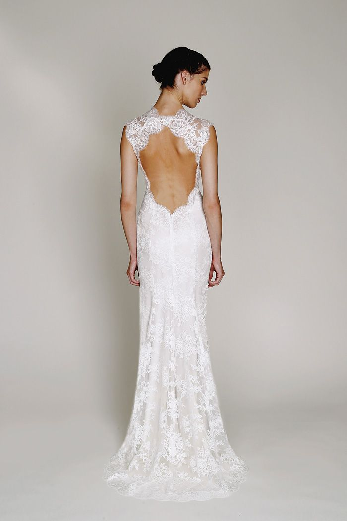 New to the Wedding Suite: Bliss Monique Lhuillier. Style BL1330, chantilly lace v-neck sheath with signature open back and front slit