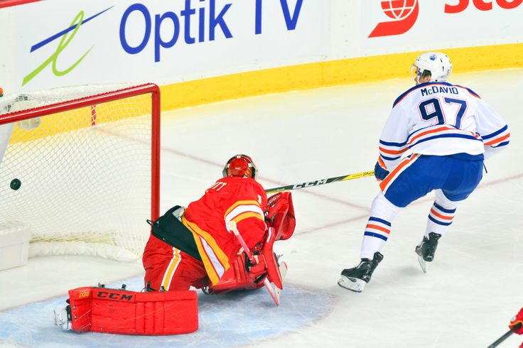Edmonton Oilers Center Connor McDavid (97) scores a goal against Calgary Flames Goalie Brian Elliott (1) during an NHL Hockey game between the Calgary Flames and the Edmonton Oilers at the Scotiabank Saddledome in Calgary, AB. (Photo by Jose Quiroz/Icon Sportswire)