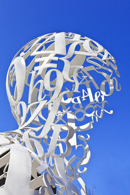 """Detail of """"Alchemist"""" by Spanish artist Jaume Plensa. Located at MIT in the grassy area between Mass. Ave. and the Stratton Student Center."""
