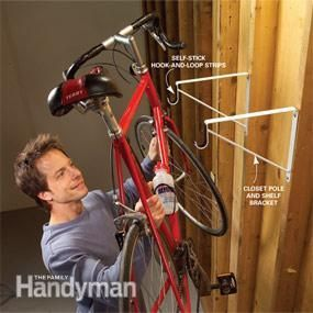 Closet pole and shelf brackets can also keep your bikes up and out of the way of car doors and bumpers. Just screw the brackets to the wall studs. Line the pole carriage with self-stick hook-and-loop strips so it won't scratch your bike frame.