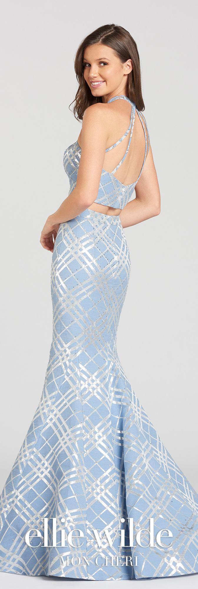 Two-piece sleeveless jacquard with heat set stones and plaid printed trumpet dress with jewel halter neckline, a cropped bodice, and a high-waisted skirt.