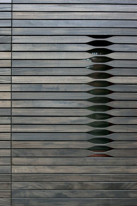 Window screening or contemporary shutters? Would love to replicate this detail on a credenza  or cabinetry. The cutouts would be the hand pulls.
