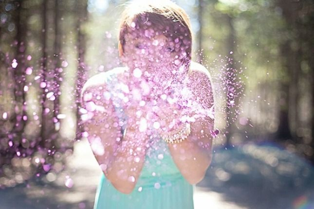 A handful of pink or blue glitter looks pretty glistening in the sun and scattering in the wind. Plus, it makes for some unique pictures you can share online or use to create photo announcement cards.