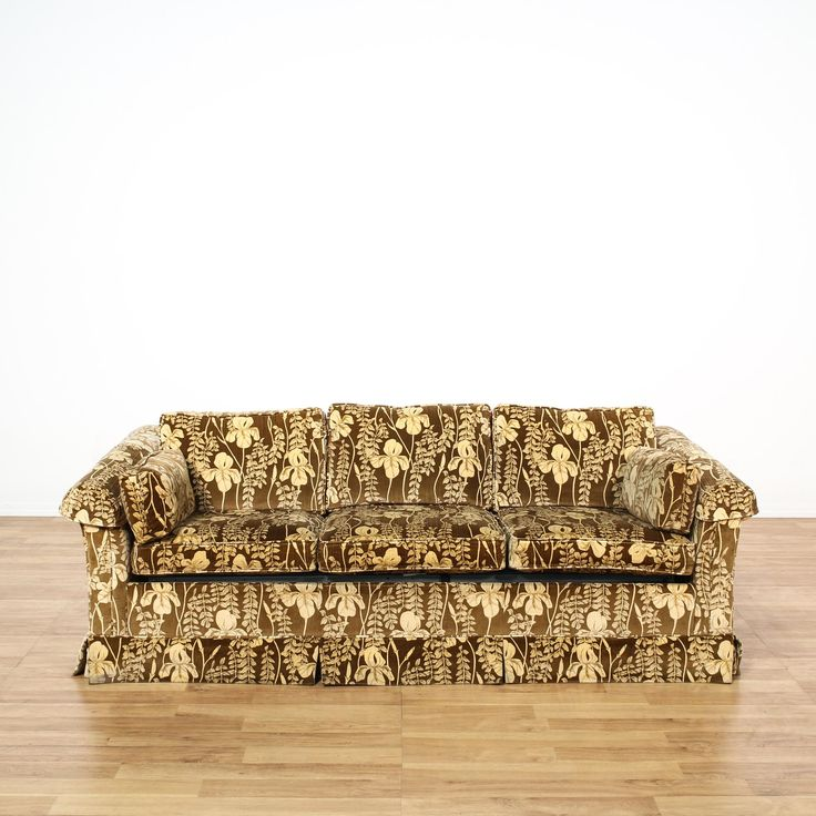 """This """"Ethan Allen"""" sleeper sofa is upholstered in a durable brown microfiber. This American mid-century couch has an all-over tropical floral print, skirted base, and matching pillows. A fun piece that's perfect for the living room! #americantraditional #sofas #sofaorcouch #sandiegovintage #vintagefurniture"""