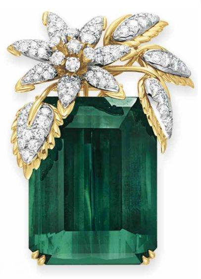 """A TOURMALINE AND DIAMOND """"FOUR LEAVES"""" BROOCH, BY JEAN SCHLUMBERGER, TIFFANY & CO.  Set with a rectangular-cut green tourmaline, weighing approximately 127.59 carats, enhanced at the top with a circular-cut diamond and sculpted 18k gold foliate spray, mounted in 18k gold and platinum, with pendant hoop for suspension  Signed Schlumberger for Jean Schlumberger, Tiffany & Co."""
