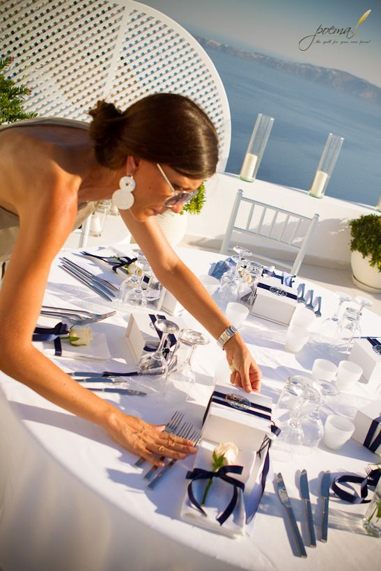 Amalia! Setting up for Berna and Haldun's Wedding Ceremony and Dinner Reception @ Dana Villas  By Poema Weddings & Special Events in Santorini & Agrokipio Flowers/Wedding Wish Decoration