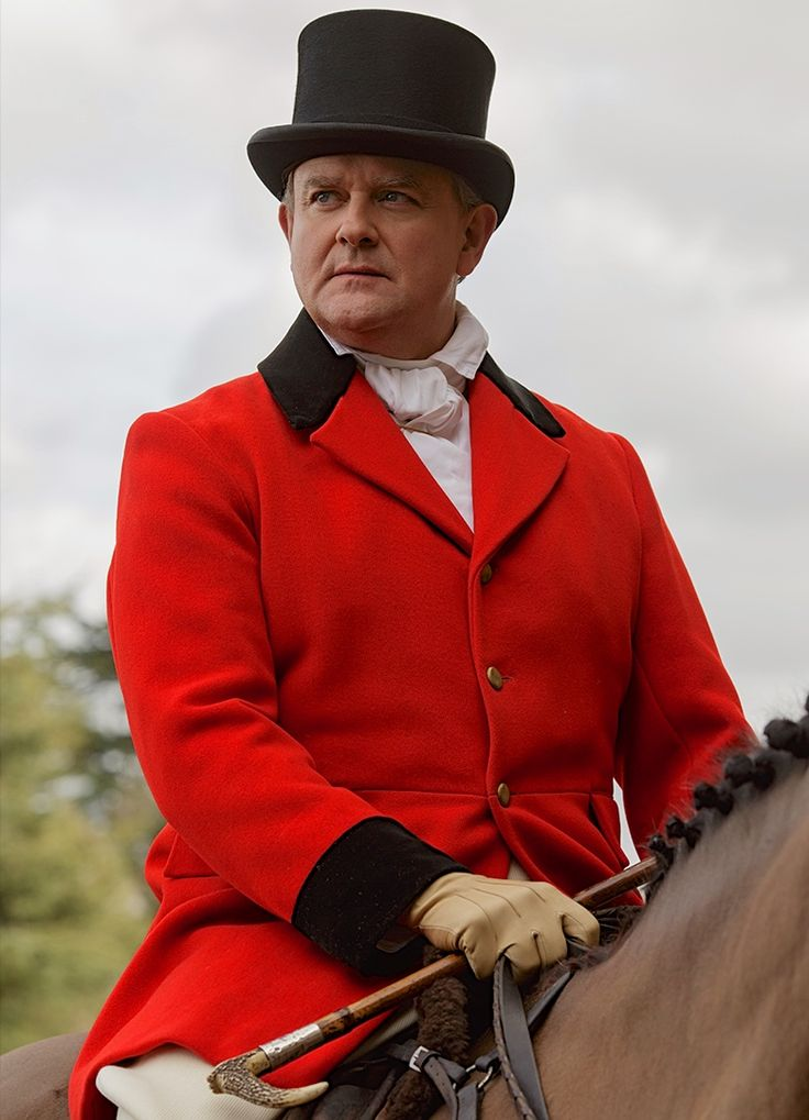 Lord Grantham on horseback wearing a red riding coat. Downton Abbey
