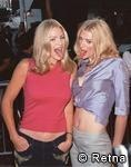 Shannon Tweed Simmons, not sure who's she's with, it doesn't look like her sister, maybe Paul Stanley's wife.