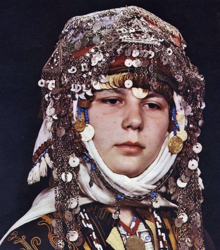 A traditional bridal headgear from the village of Merkez Kapıkaya (Kozak Yaylası, near Bergama), 1968.  Ethnic group: Alevi Türkmen.  (Source: 'Türkmen Giyimi', Sabiha Tansuğ).