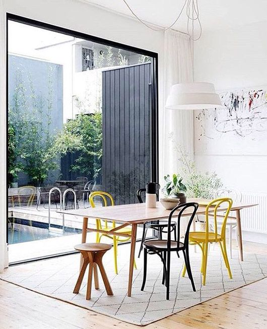 yellow and black bentwood chairs. / sfgirlbybay