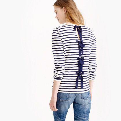 "A fun holiday twist on the classic striped T-shirt featuring grosgrain ribbon bows with a hint of shimmer along the back. <ul><li>Slightly loose fit.</li><li>Body length: 24"".</li><li>Cotton.</li><li>Bracelet sleeves.</li><li>Hand wash.</li><li>Import.</li></ul>"