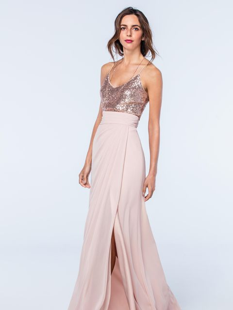 A stunning spaghetti strap tank top and skirt combination from the Watters Bridesmaids collection. The top has been beautifully designed with Eclat sequins and has been paired with a tulip slit style skirt. Product name Zoe Tank 2301 in Rosegold and Natasha Skirt in Buff.  View more Bridesmaid dresses from our Watters collection at: http://www.baroqueboutique.co.uk/bridesmaids/  Photographs courtesy of: https://www.watters.com/watters/bridesmaids/