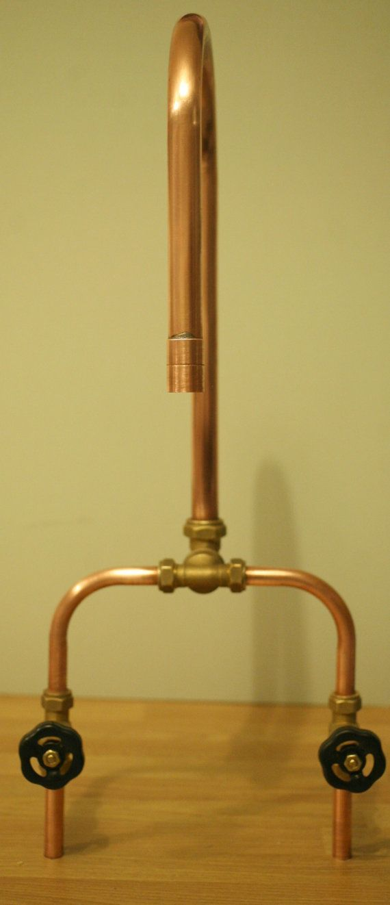 A very clever and creative way of incorporating copper pipe in a kitchen or bathroom