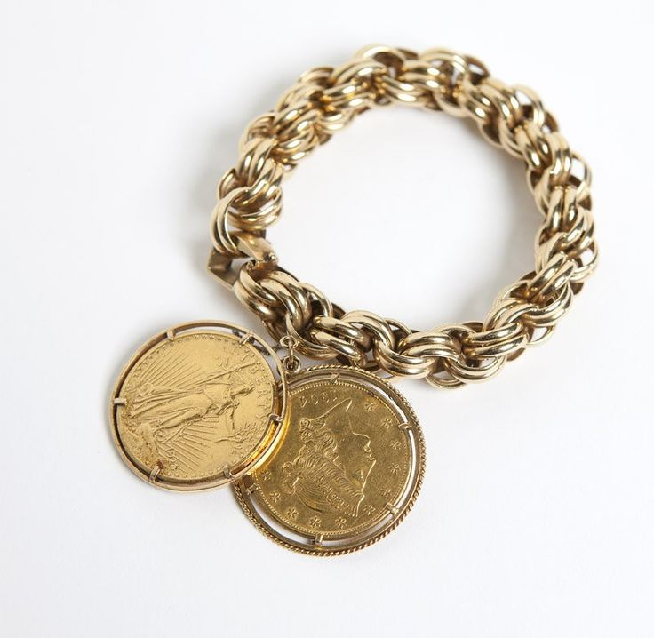 A gold coin charm bracelet : 14K gold charm bracelet suspending two high karat gold US gold $20 coins with 18K yellow gold frams, 9'', 152.5 gms