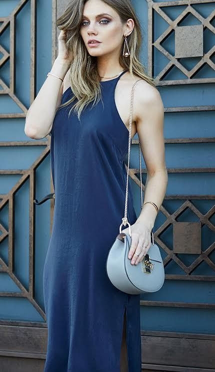Turn heads in our Slip it on Midi Dress. Complete with a side slit and high neckline detail, this dress will take you to great lengths. Shop the look over on Poshsquare.com today!