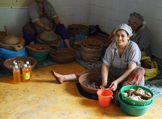 berber women making argan oil, woman argan oil collective morocco, La Carmina's Morocco travel video is out! Goats on trees, argan oil, Berber cooking classes and more - see it here! http://www.lacarmina.com/blog/2016/01/berber-family-homestay-cooking-lessons-essaouira-morocco/