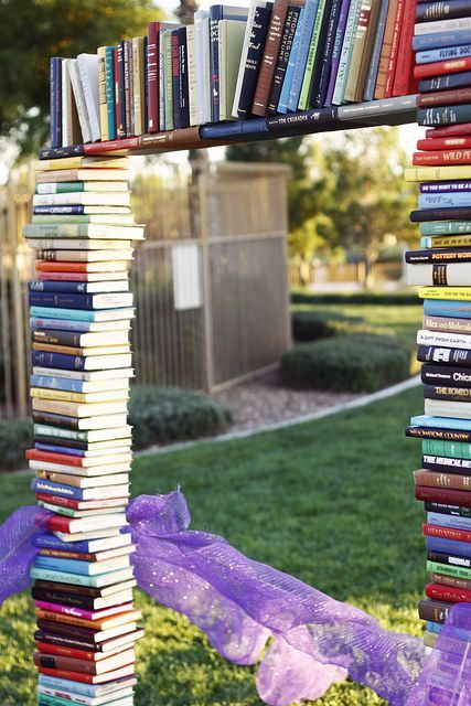 book arch decorated with purple tulle
