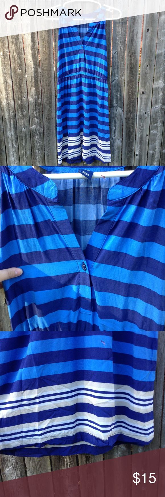 Old Navy Striped Dress This is a cute dress with blue, cream, and white colored stripes. Been used a few times. Has small wears and a small thread pull on the back of the dress. See 2nd to last photo. Old Navy Dresses