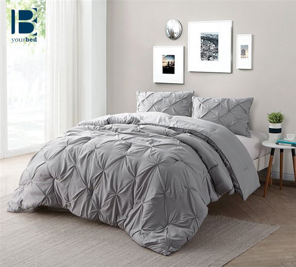 I chose these gray bed spread because it matched the theme of the room and the blush texture of the comforter and pillows made the bed seem comfortable.