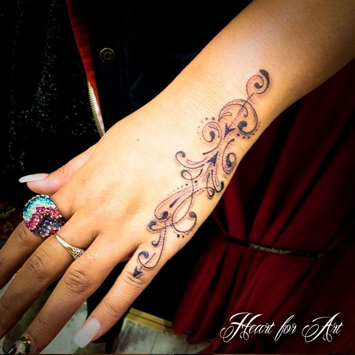 Swirl Tattoo On Girl Left Hand