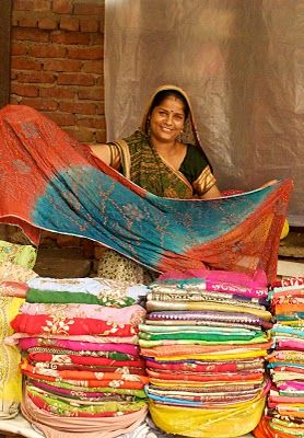 Sari vendor in Delhi, so many beautiful fabrics Fabric from India with the gold and silver threads is pretty