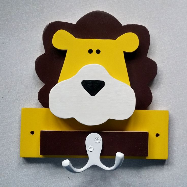 Lion shaped wall hook for a safari themed nursery. Made of 9mm birch plywood, this eco friendly clothes peg has bucket of charm and will add fun in any child's bedroom.