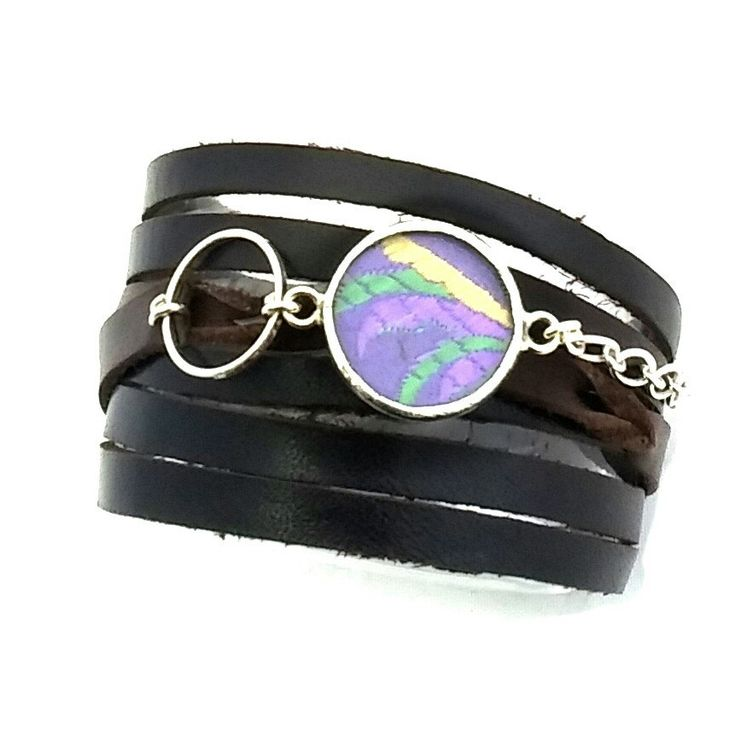 These wrap around bracelets are made of gorgeous Italian leather and feature luscious silks behind glass.