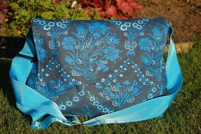 Blue patterned messenger bag, baby change bag. £40.00