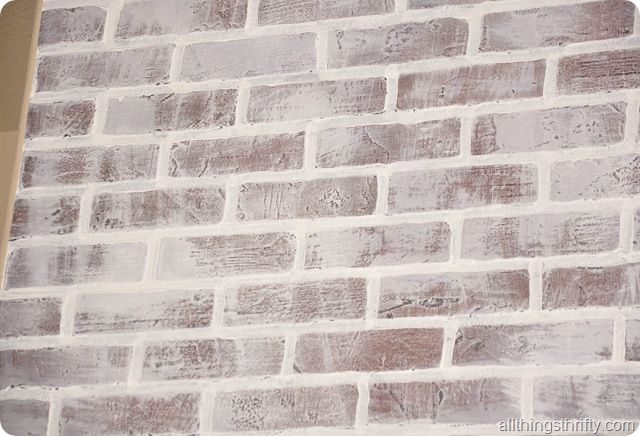 How to install faux brick panels and how to paint and distress it to look weathered and white-washed.