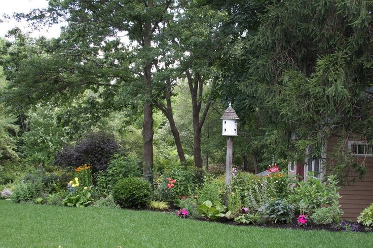 farmhouse bird feeders landscape traditional with plants ...