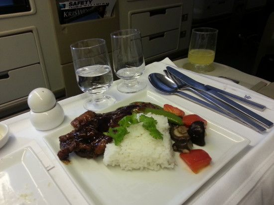 "His pre-order meal was lukewarm...but the flight attendant realised that something was wrong and without a thought, she took his plate away and within a few minutes she returned with two piping hot alternative dishes!  Fried pork with mandarin peel sauce, served with Chinese vegetables and steamed rice. (Singapore Airlines ""Book the Cook"")"