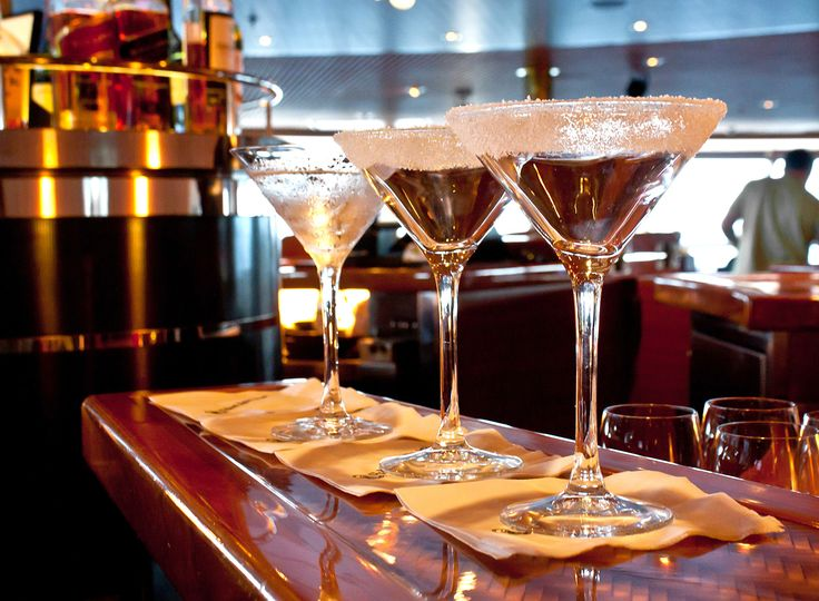I empty my drink and look around for more. As I take a deep breath, enjoying the champagne's near-immediate effect, my chest swells. Lightness and fuzziness sneak up to my head, alleviating my bad mood. When I slowly breathe out an invisible chain of alcohol fumes, the sudden urge to have a cigarette makes my pulse beat faster. I haven't smoked in years. Okay, maybe some nice guy here can help a poor girl in need.