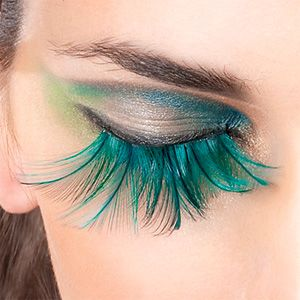 Pro tip #23: If you're thinking about using obnoxious fake eyelashes, think twice. If you're still thinking about the obnoxious fake eyelashes, at least keep the eyeshadow behind them relatively simple. (Normal fake eyelashes are fine and encouraged if you have very fine or blond eyelashes and dancing above bronze level.)