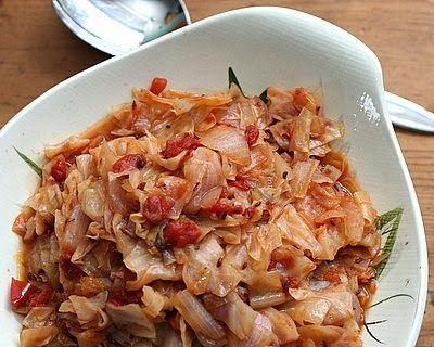 Caraway Cabbage, a favorite Finnish recipe for healthy cooked cabbage with a little tomato for pretty color, soft almost like noodles. | Low Carb, easily vegan, Weight Watchers PointsPlus 2 | KitchenParade.com