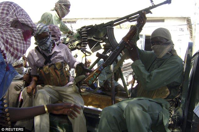 5/29/17 Islamist militants bury a man neck-deep and stone him to death for 'cheating on his two wives' in Somalia  Dayow Mohamed Hassan was killed in the village of Ramo Adey by Al-Shabaab  The 44-year-old was 'pelted with stones' in accordance with the 'Islamic sharia'   Al-Shabaab has been fighting a violent insurgency in Somalia since 2006