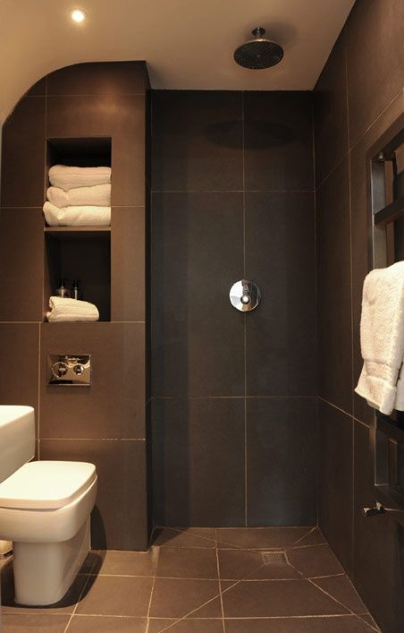 Large format charcoal tiles contrast with crisp white - Wet rooms in small spaces minimalist ...