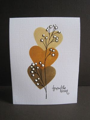 Stampin Up heart punch punched through a scrap piece of typing paper and sponged the heart with 3 colors of Ranger distress inks(Scattered Straw, Wild Honey,Brushed Corduroy)