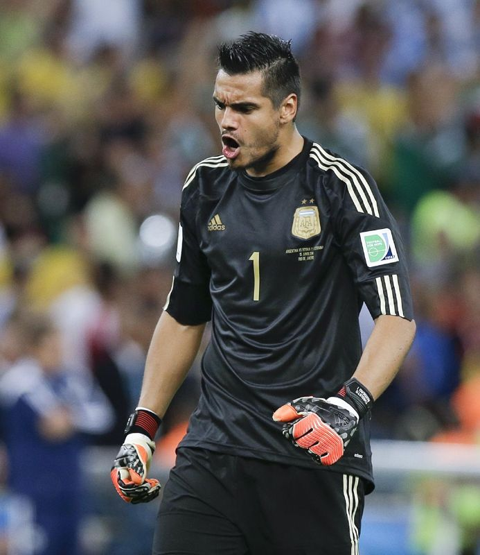 Argentina's goalkeeper Sergio Romero shouts after teammate Lionel Messi scored his side's second goal during the group F World Cup soccer match between Argentina and Bosnia at the Maracana Stadium in Rio de Janeiro, Brazil, Sunday, June 15, 2014