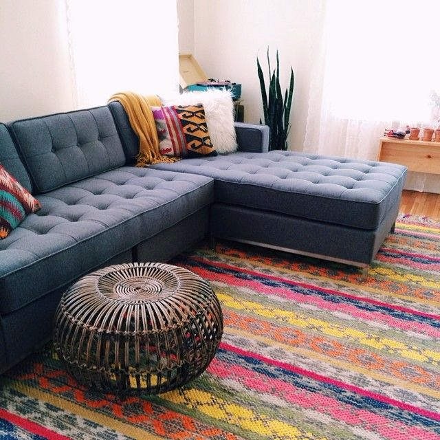 Navy Sofa, Multicoloured Rug